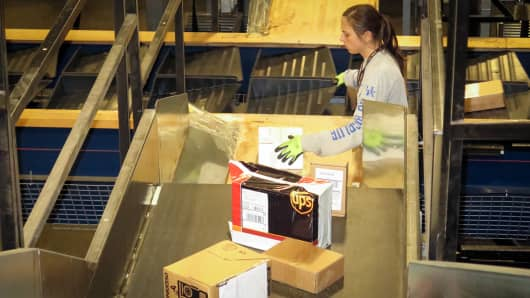 An employee sorts packages at the UPS Worldport in Louisville, KY.