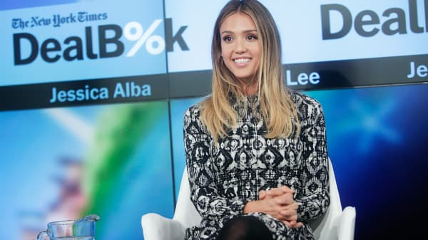 The Honest Company founder Jessica Alba speaks onstage during The New York Times DealBook Conference at One World Trade Center in New York, Dec. 11, 2014.