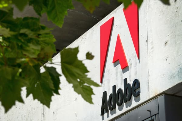 The Adobe Systems logo is displayed outside one of the company's offices.