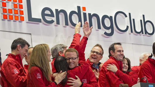Lending Club executives celebrate with company executives during the company's IPO at the New York Stock Exchange, Dec. 11, 2014.