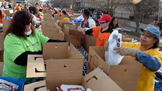 Hundreds of volunteers gather next to the Epworth United Church in Denver on Saturday, Nov. 22, 2014, to continue the legacy of Daddy Bruce Randolph who fed people on Thanksgiving.