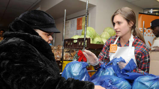 Founder of FEED, Lauren Bush Lauren, attends Feeding America Hosts Bi-Coastal Celebrity Volunteer Event at Food Bank for New York City's Community Kitchen & Food Pantry on December 11, 2014, in New York City.