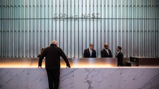 A man checks in with the Conde Nast front desk at One World Trade Center in New York.