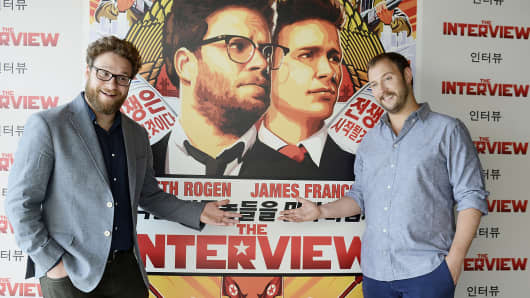 "Seth Rogen, left, and Evan Goldberg pose during a photocall for their latest film ""The Interview"" in Barcelona, Spain, June 18, 2014."