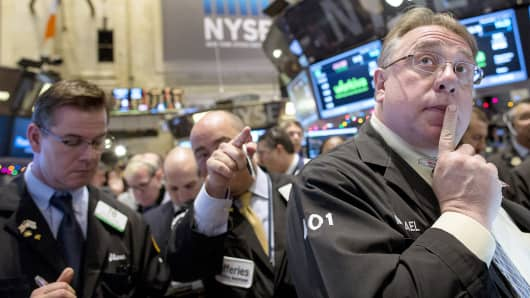 Traders work on the floor of the New York Stock Exchange Dec. 12, 2014.
