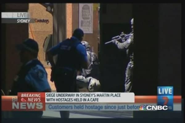 Sydney siege: Hostages taken by gunmen in cafe