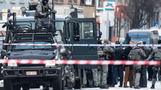 A member of the special forces police installs equipment on a van, in Ghent, western Belgium, on Monday December 15, 2014.