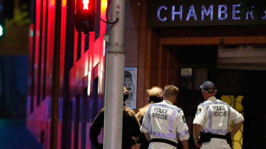 Police officers talk next to Lindt Cafe, Martin Place on December 15, 2014 in Sydney, Australia. Police attend a hostage situation at Lindt Cafe in Martin Place.