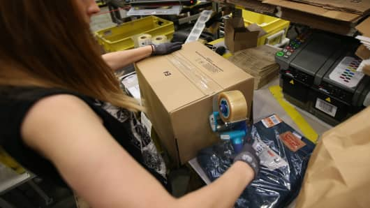 A parcel is prepared for shipment at Amazon's warehouse in Hemel Hempstead, England.