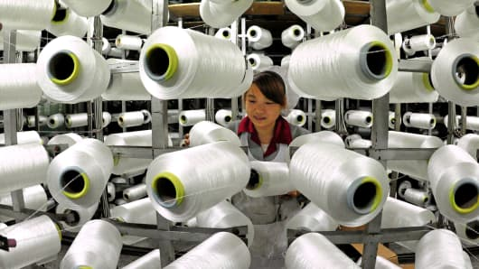 A worker is shown in a factory in Yiwu, China, Feb. 18, 2014.