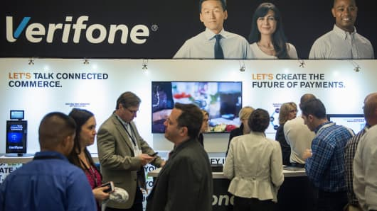 Attendees visit the Verifone Systems booth during the Money 20/20 conference in Las Vegas, Wednesday, Nov. 5, 2014.
