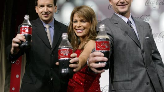 American Idol judge Paula Abdul, center, is joined by Coke executives Javier Benito, left, and Don Knauss, at the introduction of Coca-Cola new C2 cola May 24, 2004 in Los Angeles.