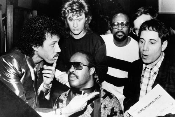 "This 1985  file photo shows Lionel Richie, clockwise from left, Daryl Hall, Quincy Jones, Paul Simon and Stevie Wonder record ""We Are The World"" by USA for Africa."