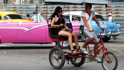 A taxi bike near the Capitolium square in Havana, Cuba.