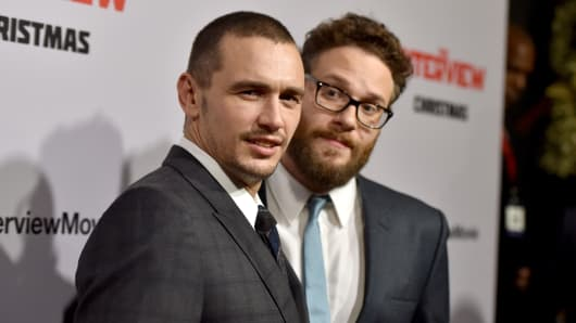 Actors James Franco (L) and Seth Rogen attend the Premiere of Columbia Pictures' 'The Interview' at The Theatre at Ace Hotel Downtown Los Angeles.