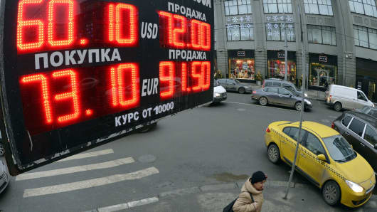 A board lists foreign currency rates against the Russian ruble outside an exchange office in central Moscow on Dec. 17, 2014.