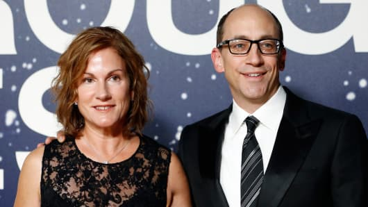 Twitter CEO Dick Costolo (R) and wife Lorin Costolo arrive on the red carpet during the second annual Breakthrough Prize Awards at the NASA Ames Research Center in Mountain View, California, November 9, 2014.