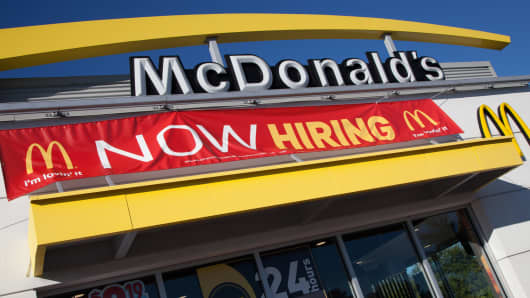 "A McDonald's restaurant with a ""now hiring"" sign, in Sarasota, Fla."
