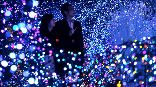 Couple looks at light-emitting diode illuminations ahead of Christmas in Tokyo, Japan