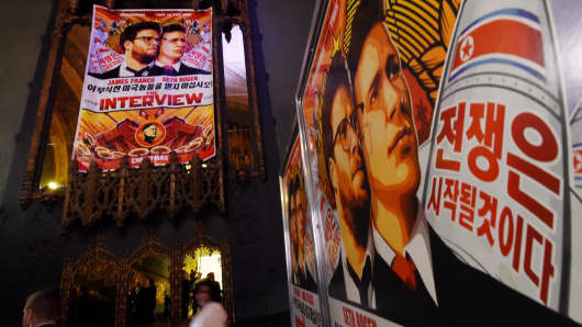Movie posters for the premiere of the film 'The Interview' at The Theatre at Ace Hotel in Los Angeles.
