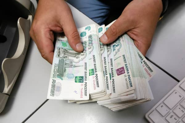An employee counts Russian ruble banknotes at an office in Siberia in December, 2014.