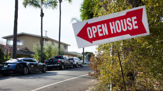 A sign advertising an open house in Corona Del Mar, Calif.