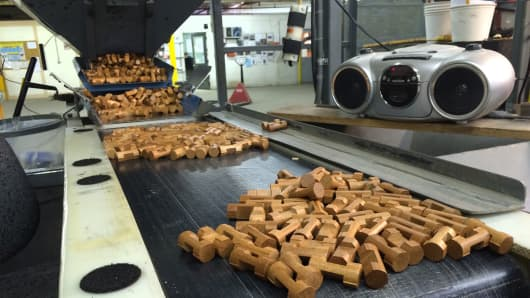 Lincoln Logs on the Pride Manufacturing assembly line in Burnham, Maine.
