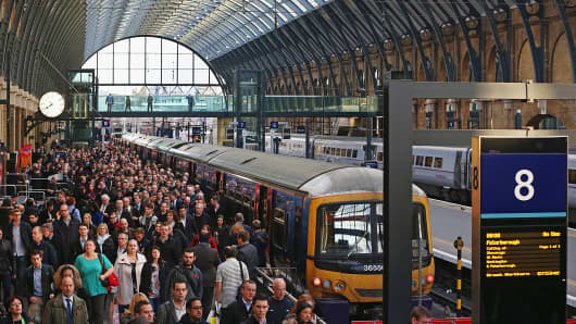 Passengers disembark a train at King's Cross station in London, Nov. 7, 2014.