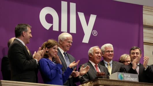 In this April 10, 2014 file photo, Ally Financial CEO Michael Carpenter, third from right, is applauded as he rings the New York Stock Exchange opening bell to mark his company's IPO.