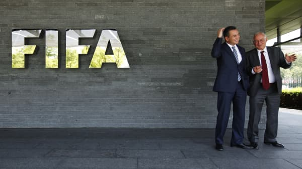 Michael J. Garcia, Chairman of the investigatory chamber of the FIFA Ethics Committee (L) and  Hans-Joachim Eckert, Chairman of the adjudicatory chamber of the FIFA Ethics Committee pose for photographers after a news conference at the Home of FIFA in Zurich July 27, 2012.
