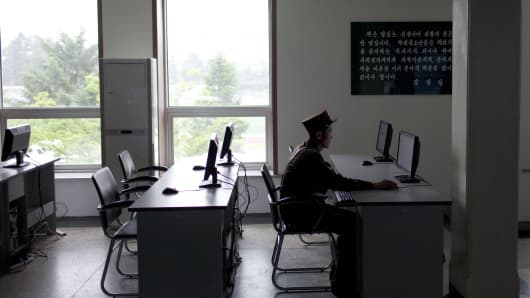 A military officer uses a computer in an electronic library at the Mangyongdae Revolutionary School, an elite military school for boys ages eleven to eighteen, on the outskirts of Pyongyang, North Korea.