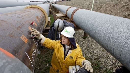 BP workers inspect a section of oil transit pipeline.