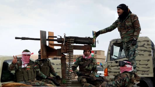 Peshmerga fighters departed from the Zommar district arrive in the Sinun town of Sinjar district of Mosul, to fight against Islamic State of Iraq and Levant, in Iraq on December 19, 2014.