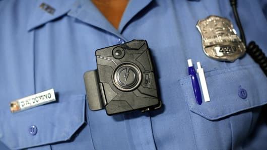 A police officer wears a body camera.