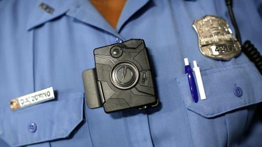 A police officer wears a body camera.