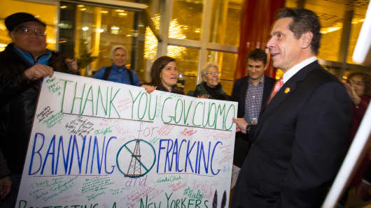 New York Governor Andrew Cuomo greets fracking protesters outside his office in New York December 17, 2014.
