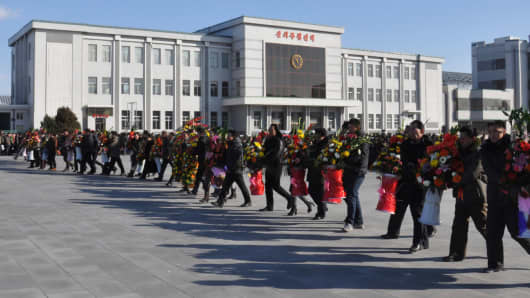 A ceremony in Pyongyang in this undated photo released December 17, 2014 by North Korea's Korean Central News Agency.