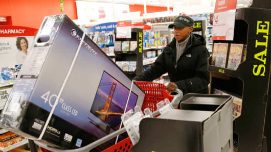 Shoppers push their carts through the checkout line at a Target store in Chicago.