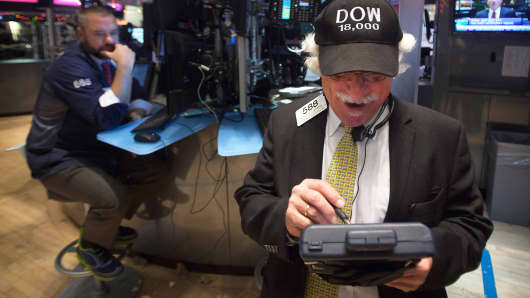 "Trader Peter Tuchman wears a ""Dow 18,000"" cap as he works on the floor of the New York Stock Exchange in New York, December 23, 2014."