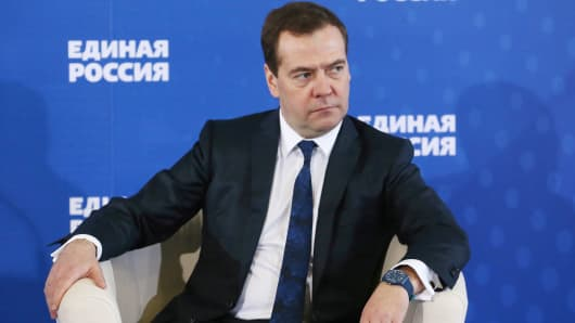 Russian Prime Minister Dmitry Medvedev listens during a meeting with senior ruling United Russia Party officials in Moscow, Russia, Dec. 23, 2014.