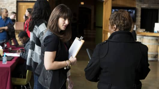 A recruiter greets a job seeker during a Virgin Hotels job fair in Chicago.