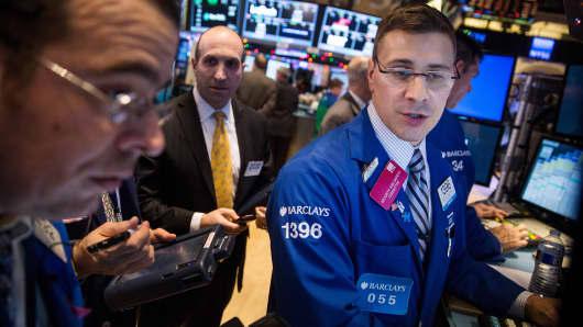 Traders work on the floor of the New York Stock Exchange, Dec. 23, 2014.