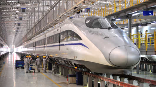 Mechanics check a high-speed train at Xi'an Electric Multiple Unit Maintenance Base