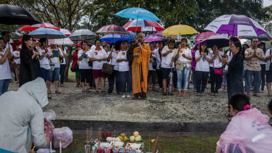 Buddhist worshipers pray for victims to commemorate the ten anniversary of tsunami at mass grave on December 25, 2014 in Banda Aceh, Indonesia.