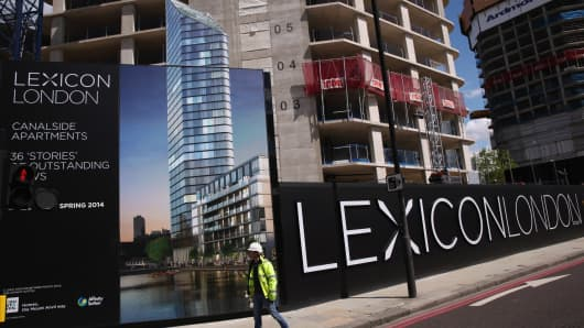 A banner advertising new 'Luxury' apartments in the East End of London.