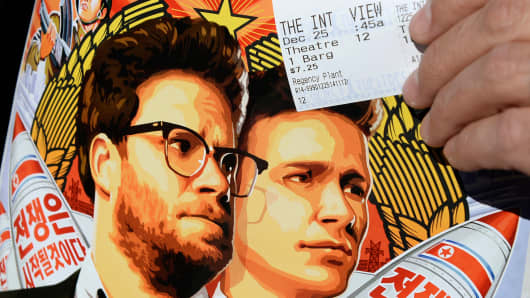 "A ticket and a poster of the film ""The Interview"" at the Christmas Day screening of ""The Interview"" in the Van Nuys section of Los Angeles, California December 25, 2014."