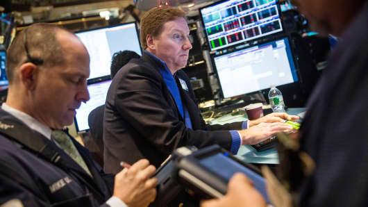 Traders work on the floor of the New York Stock Exchange, Dec. 24, 2014.