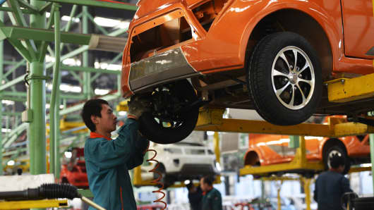 Workers assemble automobiles in a factory in Zouping, east China's Shandong province.