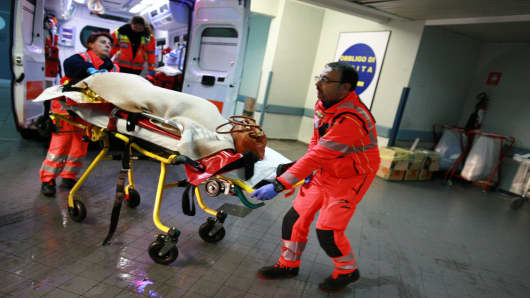 A rescued passenger arrives at the Antonio Perrino hospital in Brindisi, southern Italy, after being lifted off the burning ferry 'Norman Atlantic' adrift off the coast of Albania, on December 28, 2014.