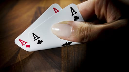 Playing cards showing two aces